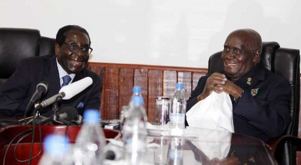 Dr Kaunda (r) with President Mugabe when they met in Lusaka