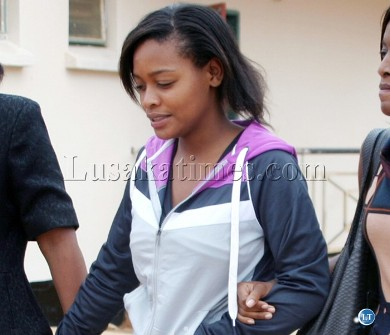 Iris Kaingu being wisked away after she was released by court