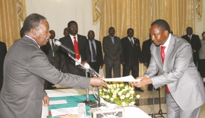 President Sata receives a letter of oath from UPND Sinazongwe member of Parliament Richwell Siamunene, who was sworn in as Deputy Minister of Commerce, Trade and Industry at State House in Lusaka yesterday. – Picture by Eddie Mwanaleza