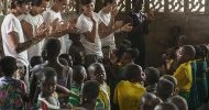 One Direction all smiles during Comic Relief trip to Africa.