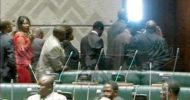 Photo of the Month: Dora Siliya (in red) raise her finger in protest of RB's immunity removal in Parliament