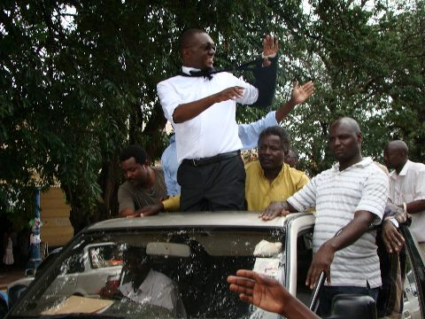 Garry Nkombo waves at the UPND supporters after he was freed by the courts