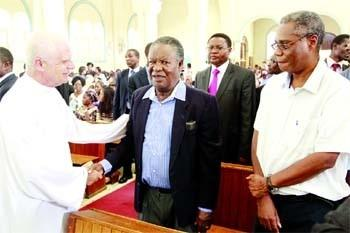 President Sata with Catholic Priest in Church on Friday