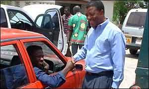 Mazoka greets a motorist