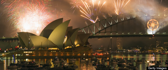 """According to this year's """"Better Life Index,"""" Australia is the developed world's happiest country. In this picture, New Year's Eve fireworks explode over Sydney harbour."""