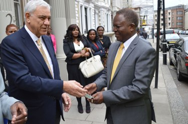 Masoud Alikhani, Chairman of BMR (left) hands over Ambulance Keys to Zambian High Commissioner to the UK, Paul Lumbi