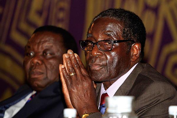 MDC leader Tsvangirai with President Mugabe