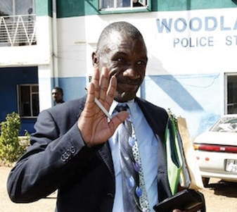 Andrew Banda waves at his sympathizers at Woodlands Police Station