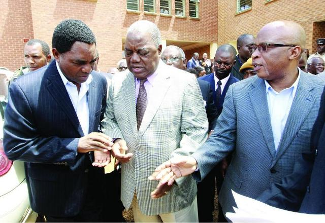File: Banda centre with HH (l) and Mumba confer outside Court in Lusaka
