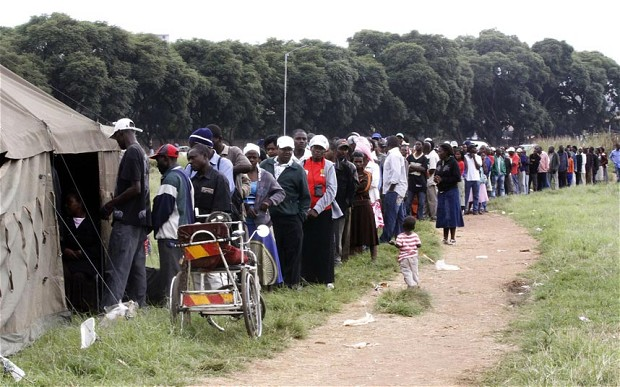 Zimbabweans formed long queues to vote in a poll that is tightly contested