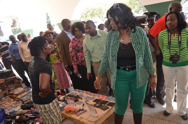 Sylvia Masebo talking to street vendors in Livingstone