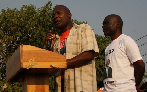 Fr. Bwalya addressing a rally when he launched his party in Kitwe behind him is Chilekwa