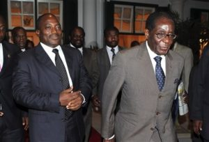 File: President Mugabe, right and Congolese President Joseph Kabila, seen, after their meeting at State House, in Harare, Nov. 2, 2009.