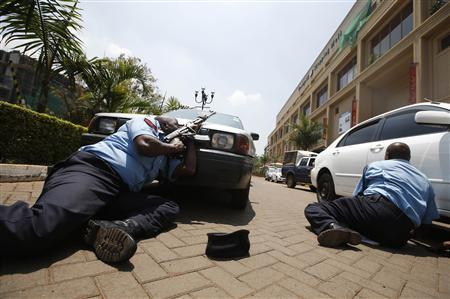 Police take cover outside Westgate shopping centre where gunmen went on a shooting spree in Nairobi September 21, 2013.  Credit: REUTERS/Goran Tomasevic