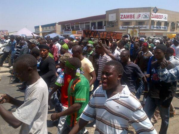 PF cadres protesting with a mock coffin writen Wynter