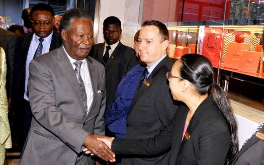 President Michael Sata greets New York Palace Hotel's staff on arrival in New York for the 68th General Assembly session on September 23,2013 -Picture by THOMAS NSAMA