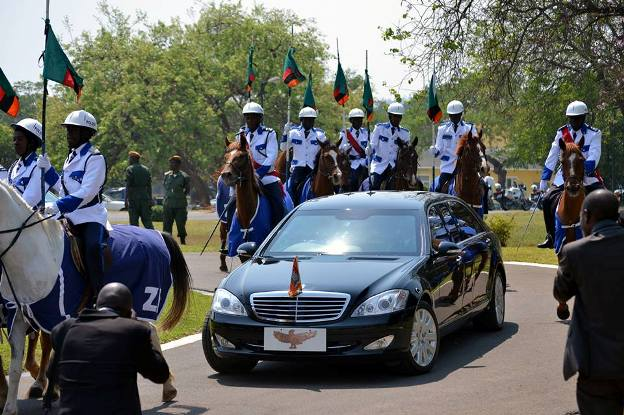 President Michael Sata's official vehicle is accompanied by mounted  police on arrival at the National Assembly building. Picture by  STEPHEN KAPAMBWE.