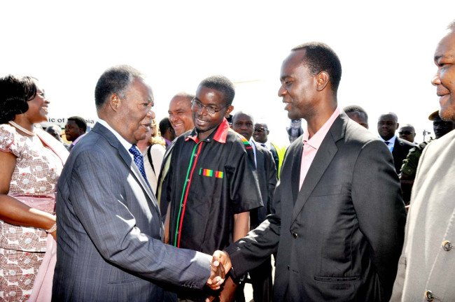 President Sata greets his Son Mulenga while Cosmo Mumba looks on recently in Livingstone