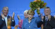 Angela Merkel celebrates after German election win
