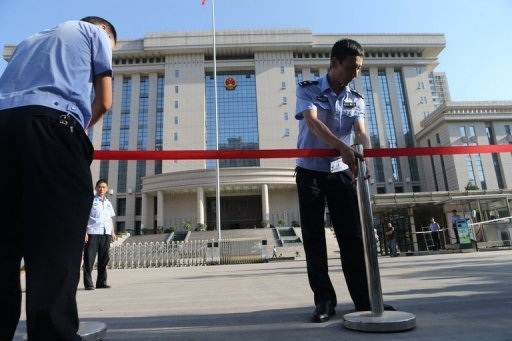 """AFP/AFP/File - Police set up a cordon outside the courthouse in Xian, Shaanxi province, on August 30, 2013, where Yang Dacai was being tried for corruption. Yang who became known as """"Brother Watch"""" because of his taste for luxury timepieces was convicted of corruption and sentenced to 14 years in prison on Thursday  less"""