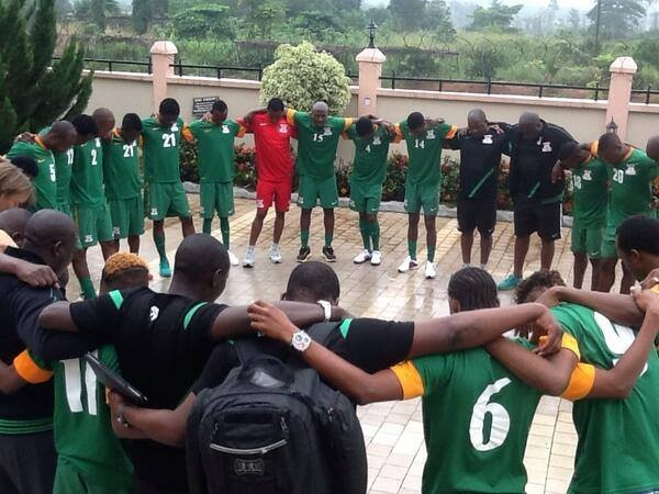 United in battle: Chipolopolo pray before the start of their traditional pre-match 'rite' at the team hotel.