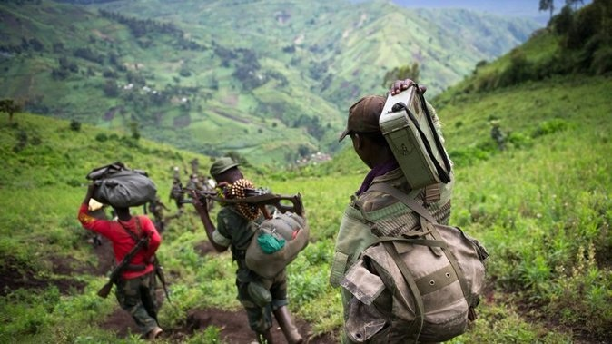M23 rebels leave the village of Karuba, eastern DR Congo, on November 30, 2012. The rebeles say they are waiting for a government delegation to arrive to resume peace talks, in line with an ultimatum set by regional leaders