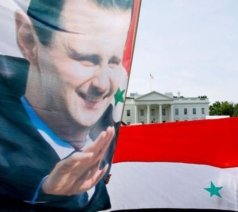 Supporters of Syrian President Bashar Al-Assad take part in a demonstration in front of the White House in Washington, DC, on September 9, 2013 urging the US not to attack Syria/AFP