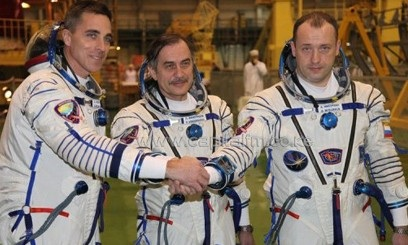 Russian cosmonauts, Pavel Vinogradov (C), Alexander Misurkin (R), and US astronaut Christopher Cassidy during training at Kazakhstan's Baikonur cosmodrome on March 17, 2013. The three returned to Earth Wednesday on board a Russian Soyuz capsule after a half-year mission on the International Space Station (ISS), landing in Kazakhstan, mission control in Moscow announced. (AFP/File)