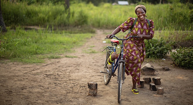 Sister Angelique Namaika on her bicycle in Dungu, DR Congo on August 3, 2013. CREDIT/AFP