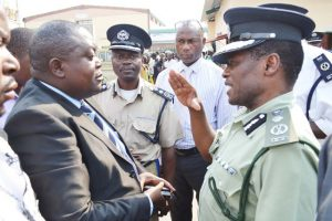 File: Chikwelete (r) talking to Deputy Police Chief Solomon Jere outside State House when he lead a protest