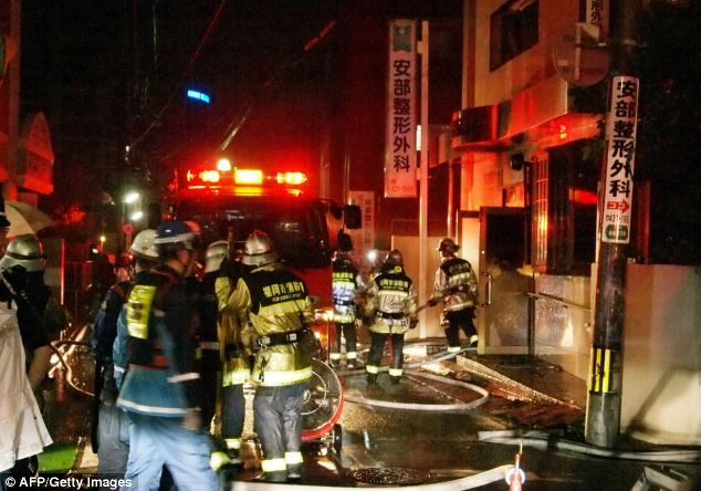 Tragic: Fire crews pictured tackling a fire that broke out at an orthopaedic hospital in Japan.