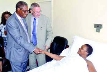 File: Guy Scott and Emmanuel Chenda when they visited Masebo at the Hospital.