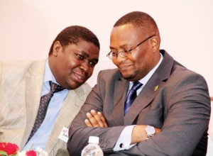 File: Nalumino (l)confers with Emmanuel Mwamba who is now PS for Information