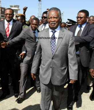 Far left in spectacles Mwamba at the Airport