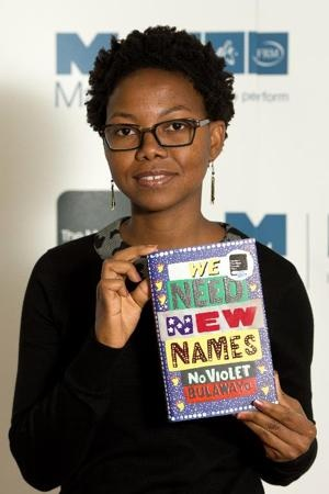 """Zimbabwean author NoViolet Bulawayo holds her shortlisted book """"We Need New Names"""" in London, on October 13, 2013 (AFP Photo/Leon Neal)"""