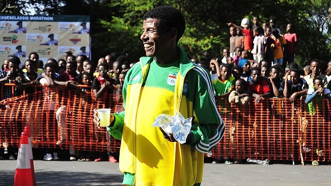 Ethiopian athletics legend Haile Gebrselassie smiles on October 20, 2013 before Ethiopia's fist-ever marathon in Hawassa. Gebrselassie, who organised the marathon, says staying fit in middle aged is all about being disciplined. Picture: AFP