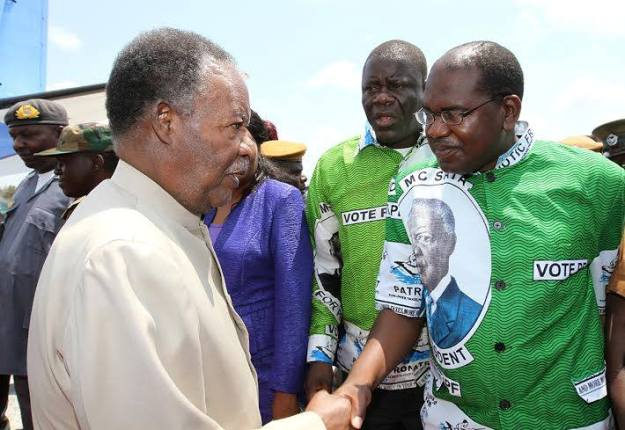 President Michael Sata greets PF parliamentary Candidate Dr Chitalu Chilufya on arrival in Mansa to drum up support for him on Tuesday, 20th Novermber 2013- Picture By Eddie Mwanaleza.