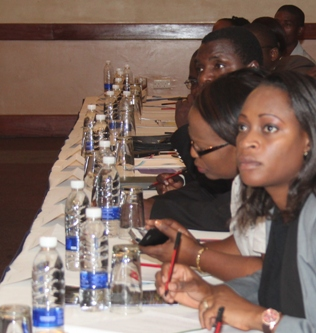 Delegates following the proceedings