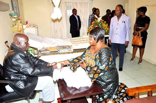 First Lady Dr. Kaseba greeting KK while President Sata looks on.