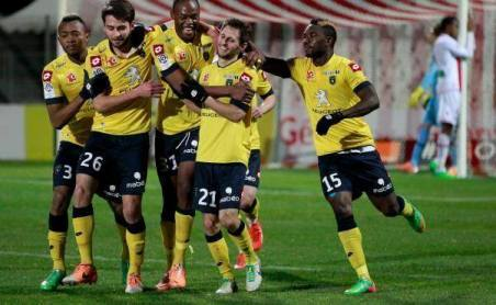 Mayuka right joins Sunzu with his team mates in celebrating