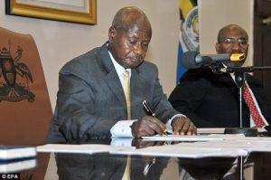 Uganda's President Yoweri Museveni signs a new anti-gay bill that sets harsh penalties for homosexual sex, in Entebbe, Uganda