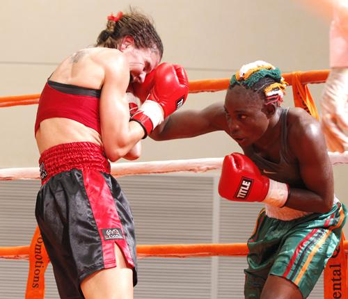 File: Catherin Phiri lands a jab on Canadian opponent Nathalie Forget during the World Professional Boxing Federation (WPBF) Bantamweight World title fight at Government complex in Lusaka on Saturday night - Photo: Post Newspaper
