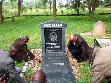 Dr Mumba on his Mother's grave