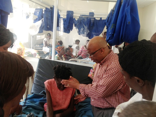 Dr Mumba praying for the sick at Lewanika General Hospital