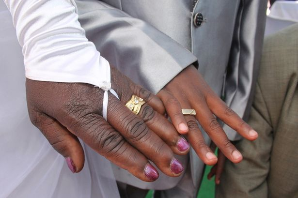 Couple after wearing rings