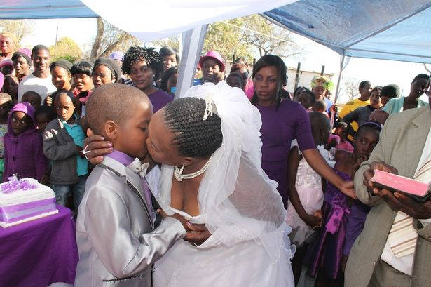 Sealed with a kiss: Sanele, 9, and bride Helen, 63