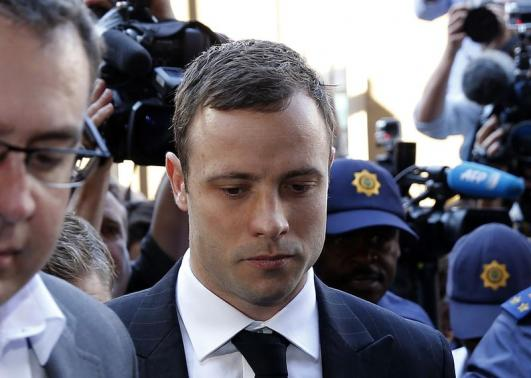 South African Olympic and Paralympic track star Oscar Pistorius arrives for the verdict in his murder trial at the high court in Pretoria September 11, 2014.