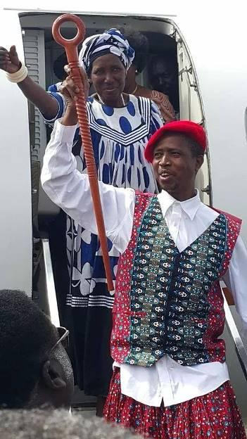 Lungu accompanied by Inonge Wina disembarking from a plane