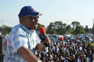 Nevers Mumba speaking at the rally