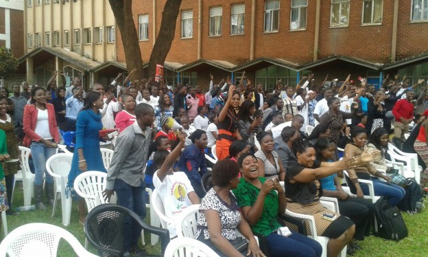 Elated students flash the UPND symbol
